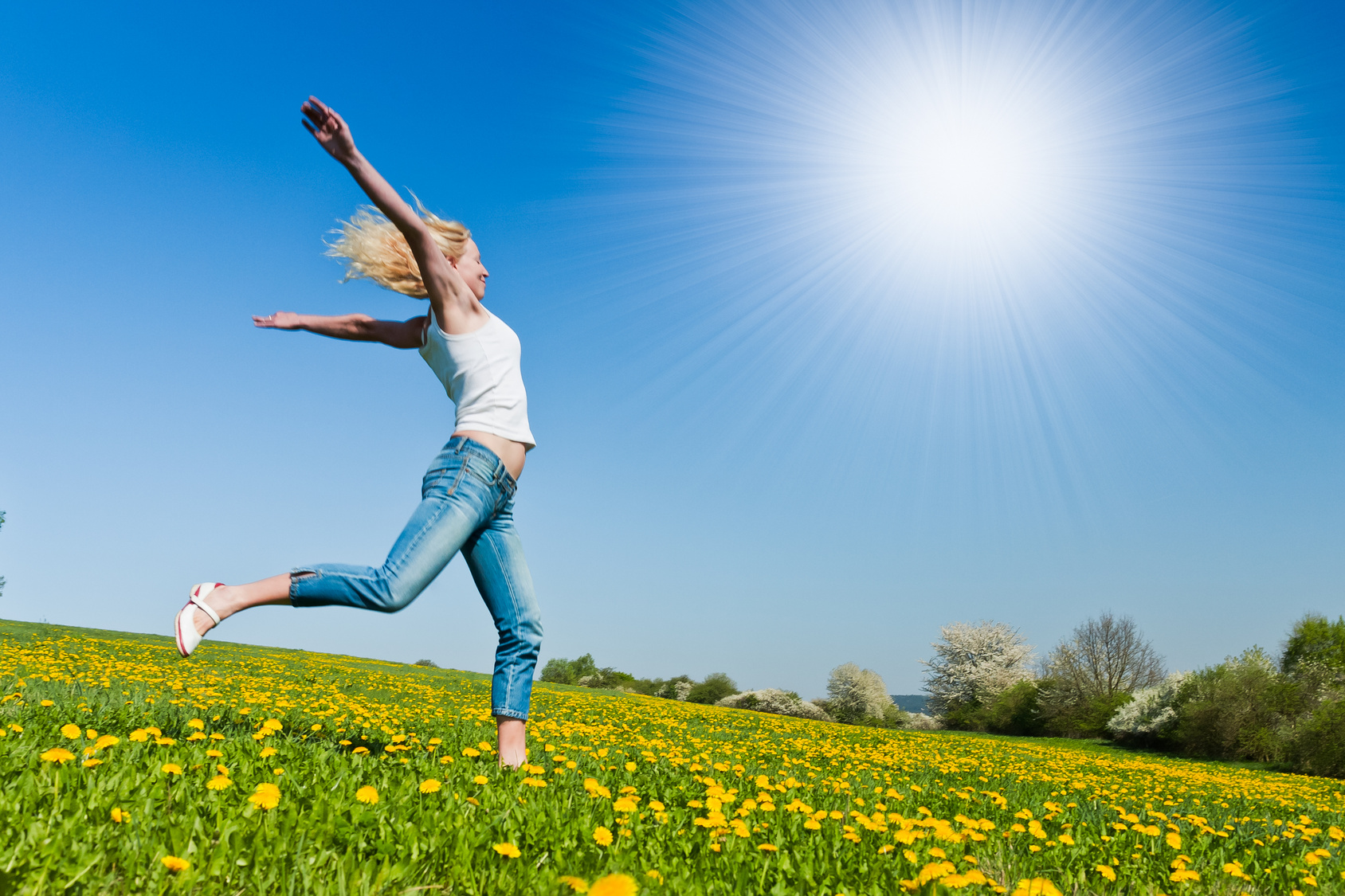 happy young woman on meadow