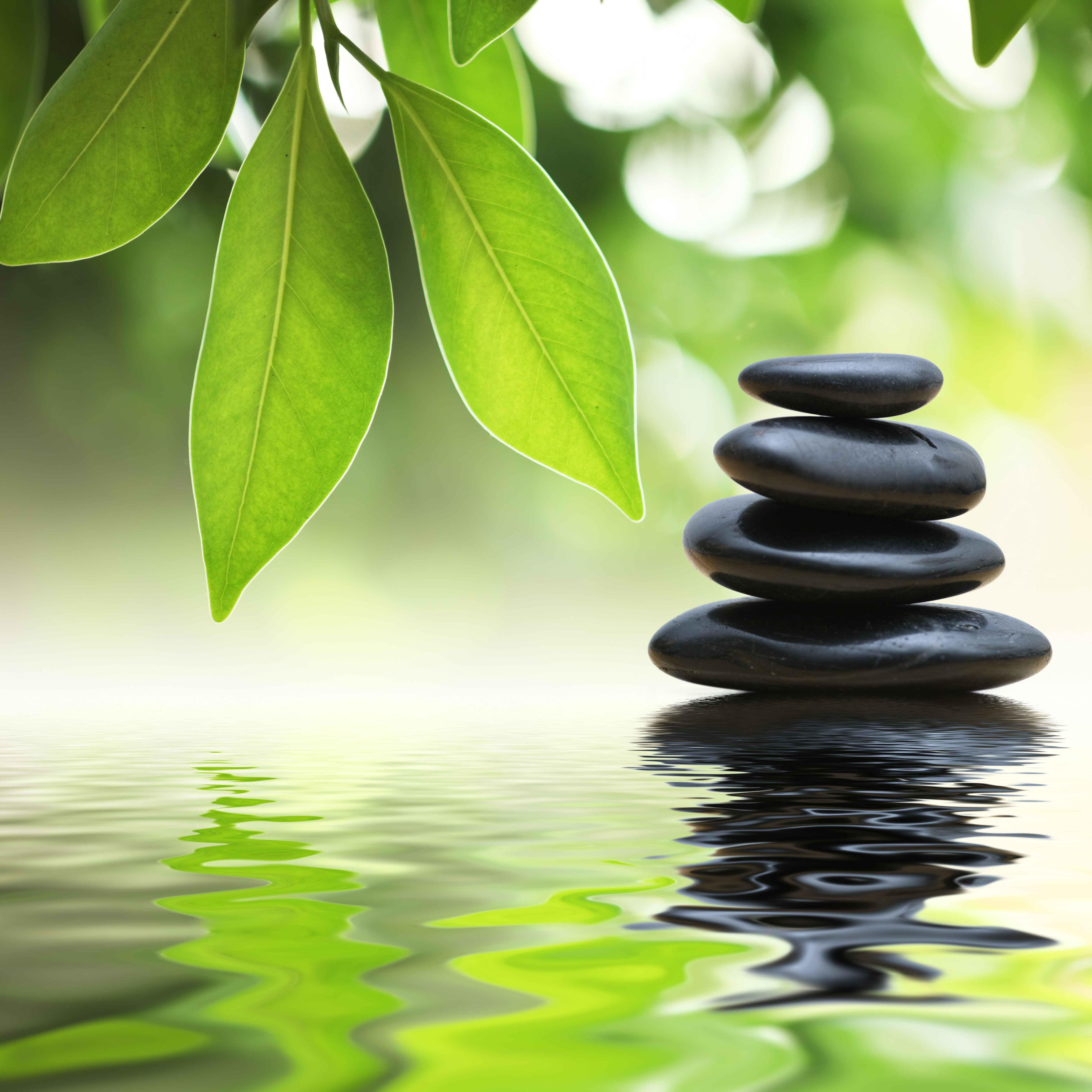 Zen stones pyramid on water surface